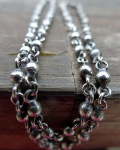 Bench Made Sterling Silver Ball Chain. This beaded chain is made by hand soldering solid silver balls to silver rings in an elegant pattern.  The chain looks fantastic with or without a pendant. Each piece is made by hand, beautifully imperfect, made to pass down for generations and as unique as we are.  Enjoy.