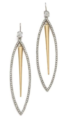Contrast spikes sway between crystal-encrusted ovals on french-hook earrings by Juicy Couture.