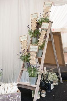 So cute! Rustic table seating chart in flower pots