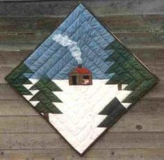 cute little quilted scene that would make a good center medallion, or for the center of Eleanor Burns' delectable mountains quilt