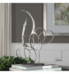 Swirling circles add a modern vibe to the Uttermost Admiration Silver Bird Sculpture , made of metal in a sleek silver finish. This lively bird sculpture. Bird Sculpture, Modern Sculpture, Organic Sculpture, Sculpture Ideas, Reclaimed Furniture, Wood Furniture, Jellyfish Lamp, Bird Statues, Wood Dust