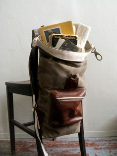 chair bag - image only - looks like a big duffle bag attached to back of chair with straps.