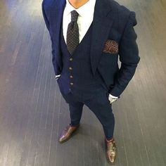Pairing a dark blue check three piece suit and a white oxford shirt will create a powerful and confident silhouette. Mix things up by wearing dark brown leather double monks.   Shop this look on Lookastic: https://lookastic.com/men/looks/three-piece-suit-dress-shirt-double-monks/24015   — White Dress Shirt  — Charcoal Polka Dot Tie  — Burgundy Polka Dot Pocket Square  — Silver Watch  — Dark Brown Leather Double Monks  — Navy Check Three Piece Suit