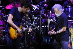 John Mayer left, and Bob Weir of Dead & Company perform at Broomfield's 1stBank Center in November. The band will play CU's Folsom Field