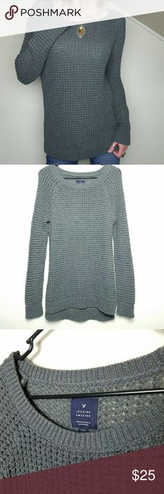 AEO Gray Jegging Sweater Gray chunky sweater. Slightly longer in back. Ribbed cuff and hem with side vents.   Excellent gently preloved condition with no rips, holes, snags or stains.   No holds, trades or off-posh transactions. Price is firm. American Eagle Outfitters Sweaters Crew & Scoop Necks