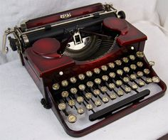 Vintage Royal dark red typewriter (with ribbon covers that look like quotemarks!)