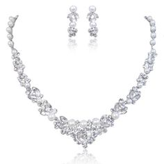 RETURNED. Cheap looking. $47.99. Free return. Bridal Leaf White Simulated Pearl Necklace Earrings Set Clear Austrian Crystal Silver-Tone Ever Faith,http://www.amazon.com/dp/B00IM3YSW8/ref=cm_sw_r_pi_dp_ZBJltb08NMJN58EV