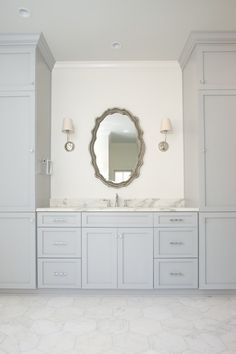 """""""Her"""" master bath vanity with 10 inch hex marble makes for a beautiful place to get ready in the morning."""