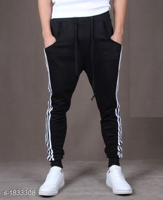 Track Pants  Voguish Polyester Blend Men's Track Pant  *Fabric* Polyester Blend  *Size* S- 28 in, M - 30 in, L - 32 in, XL - 34 in, XXL - 36 in  *Length* Up To 39 in  *Type* Stitched  *Description* It Has 1 Piece Of Men's Track Pant  *Pattern* Striped  *Sizes Available* XXS, XS, S, M, L, XL, XXL *    Catalog Name: Voguish Polyester Blend Men's Track Pants Vol 1 CatalogID_241096 C69-SC1214 Code: 382-1833308-