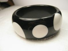 """Vintage Black Resin Bangle Bracelet with Large White Polka Dots - 7.5"""" inside measurement, 1.25"""" wide - 2.75"""" opening. Thick, no seams. The white dogs are inset in the bracelet and not painted - they"""