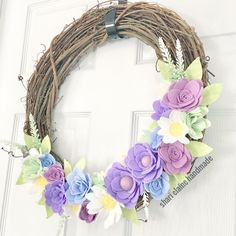 It's snow again but spring flowers are blooming here! I'm really excited about how this wreath turned out! And I'm down to 12 days to prep for my next craft show...No more procrastinating...time to make the flowers! #feltflorist #feltflowers #feltflowerwreath #grapevinewreath #springdecor #handmadeinmichigan #madeinmichigan #madewithlove #sharielainehandmade #purpleflowers #purpledecor
