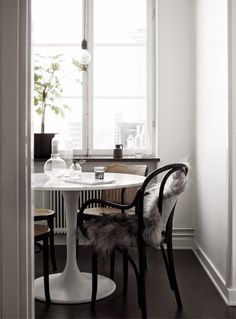 black chairs and white table. Instant Cozification: Put a Furry Throw On It | Apartment Therapy