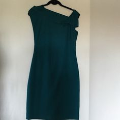 "TAHARI Gorgeous Size 8 dress Very dressy ,Worn once ,dry cleaned ,Teal color ,Little smaller  to size  . If you are size 6 or little above it will be ok! 64% polyester,34% rayon viscose, 2% spandex .Length 37,5"" Tahari Dresses"