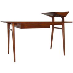 "Rare desk by Bertha Schaefer  Italy  1950's  Very rare desk designed by Bertha Schaefer for M Singer & Sons. Italian walnut, single center drawer with flaring letter tray on tapered legs. Measurements below are to top of desk surface. Additional 9"" to top of letter tray."