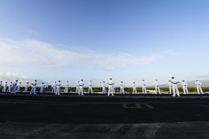 PEARL HARBOR (Dec. 3, 2013) Sailors man the rails of the aircraft carrier USS Nimitz (CVN 68) as the ship enters Pearl Harbor. Nimitz is in Pearl Harbor for a scheduled port visit during their transit home after an eight-month deployment to the U.S. 5th, 6th, and 7th Fleet areas of responsibility. (U.S. Navy photo by Mass Communication Specialist 3rd Class Derek A. Harkins/Released)