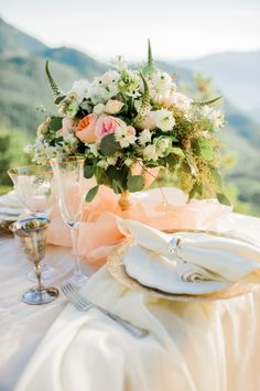 Wildly pretty rose and ranunculus florals: http://www.stylemepretty.com/canada-weddings/british-columbia/2015/09/04/romantic-mountaintop-wedding-inspiration/ | Photography: Belluxe Photography - http://www.belluxephotography.com/
