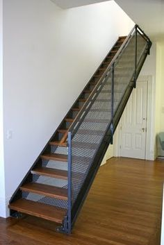open staircase with wood treads and risers | stairs with wood treads and perforated steel risers. | stairs