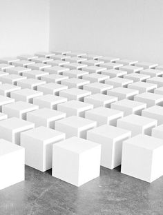 Grid/Matrix: This installation features equally sized cubes arranged in a grid. They are all spaced equally.