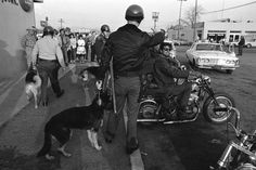 "<b>Not published in LIFE.</b> ""Buzzard"" prepares to leave Bakersfield as cops and townspeople watch, 1965."