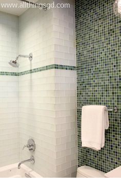 Green and white glass tiled bathroom