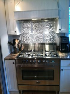 Fabulous Tin Interiors that Bring Vintage Style from Backsplashes to Wallpaper Stainless Steel Stove Fabulous Tin Backsplash Farmhouse Kitchen Decor, Home Decor Kitchen, Diy Kitchen, Kitchen Ideas, Kitchen Inspiration, Kitchen Designs, Kitchen Furniture, Wood Furniture, Eclectic Kitchen
