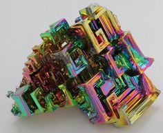 Bismuth Crystal .75-1.25 Inch Information Card Included Bismuth crystals, with their unusual box-like configuration, do not occur in nature. These man-made crystals are grown from molten bismuth in a