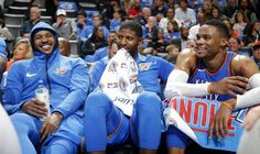 Oklahoma City's Carmelo Anthony, left, Paul George and Russell Westbrook (0) laugh as they sit on the bench during the final minutes of an NBA basketball game between the Oklahoma City Thunder and the New York Knicks at Chesapeake Energy Arena in Oklahoma City, Thursday, Oct. 19, 2017. Oklahoma City won 105-84. Photo by Bryan Terry, The Oklahoman