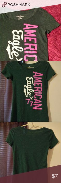 """For Patty's Day Buy American Eagle Tee Green! In Perfect Like New Condition.  Only worn a few times.   Brand: American Eagle Outfitters   Hunter Green tone. Short Sleeves,  Perfect for the upcoming spring season!  Size XS (Juniors), About 15"""" inch bust. Measurements taken flat.   Smoke/Pet Free Home.  No Trades. Reasonable Offers Accepted.  Have a lovely day! (: American Eagle Outfitters Tops Tees - Short Sleeve"""
