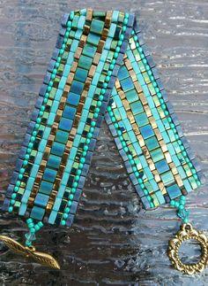 Turquoise bracelet,Beautiful. Turquoise Tila and Half Tila Bracelet, Turquoise, Green, Gold and More, Pretty Toggle, Women's, Beadwork, Hot by Puckho on Etsy https://www.etsy.com/listing/232058134/turquoise-braceletbeautiful-turquoise