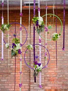 Bicycle Themed Wedding Ideas. Bike wheels hung with ribbons and flowers.