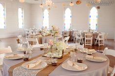 Love the round tables, white chairs, wiith the burlap, lace, and mason jars. I would have different colors, but overall almost the look I'm going for.