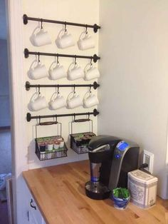 Hanging objects creates more room in any space. We love this idea of not only creating more counter space but cabinet space as well by hanging coffee mugs!