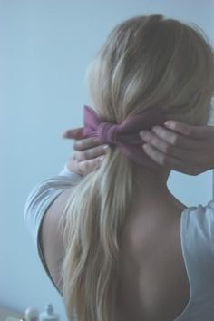 simple pony tail with pink bow