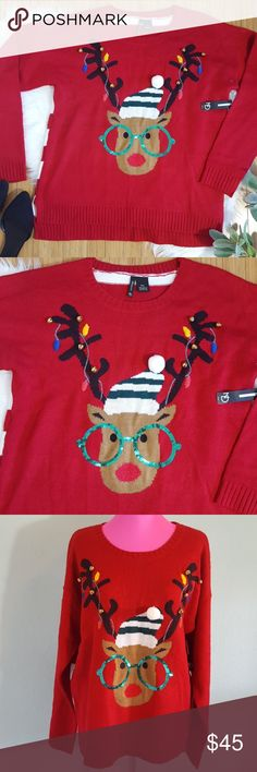 """NWT Nerdy reindeer Christmas sweater Quite possibly the cutest ugly Christmas sweater ever! Bright red sweater with """"nerd"""" reindeer, sequin accented glasses, jingle bell and pompom accent. Please note pom pom is slightly loose but still intact.  Never been worn. Split sides, ribbed hem. Back is white and red stripes.  Measurements taken laying flat  Bust: 21.5 inches Length: 25.5 inches Sleeves: 20 inches new directions Sweaters"""