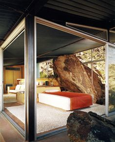 Frey house II, Palm Springs CA 1965. The bottom shot shows the famous bolder intersecting the bedroom, with the light switch installed directly on the stone (previously). Via, 2, 3, photos (C) Julius Shulman