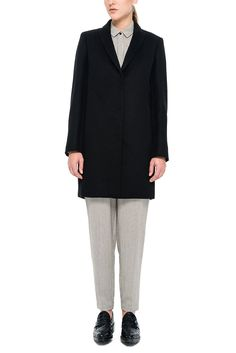 Our wool-blend black 'Stein' coat is elegant, boxy yet fitted and has a unique cape detail at the back. We integrated non-functional menswear buttonholes into the coat's raw-edge hem for a fresh feel. Stylish casual minimalist outfit | Minimalist casual wear | Capsule wardrobe | Slow fashion | Simple style | Minimalist style | Stylish business casual | Scandinavian casual wear | Stylish work outfit by Behno