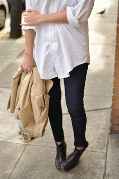 A simple, white collared shirt worn like a tunic over leggings and boots.
