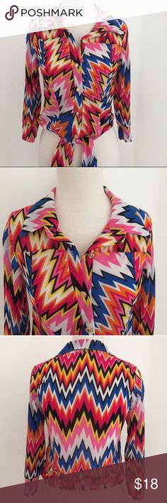Chevron Multicolor Top from Go Jane This printed top is from Go Jane and is the definition of colorful👌🏼 the waist is elastic and has a tie available to cinch up the waist and make it extra CALIENTE🌶. The gold buttons are in amazing condition. The size is a small and has never been worn☺️ Go Jane Tops Button Down Shirts