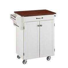 Home Styles Cuisine Kitchen Cart in a white finish with a 3/4-inch Cherry finished wood top features solid wood construction and Utility drawer; 2 cabinet doors open to storage with adjustable shelf inside; Handy spice rack, Towel bar; Heavy duty locking rubber casters for easy mobility and... more details available at https://furniture.bestselleroutlets.com/game-recreation-room-furniture/home-bar-furniture/bar-serving-carts/product-review-for-home-styles-cuisine-cart-white-f