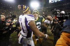 Green Bay Packers quarterback Aaron Rodgers (12) hugs Minnesota Vikings quarterback Joe Webb (14) after an NFL wild card playoff football game Saturday, Jan. 5, 2013, in Green Bay, Wis. Packers won 24-10.