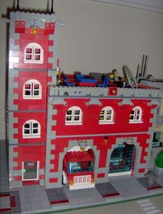 Two Bay Tower Fire House :: LEGO creations. A traditional urban fire station. My first large scale MOC since my return from the dark ages. Lego Village, Lego Fire, Lego Modular, Awesome Lego, Cool Lego Creations, Custom Lego, Lego Stuff, Diesel Trucks, Lego Building