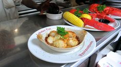 Fresh scallops broiled to perfection and 2 steamed lobsters.