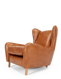 The Rubens Wingback Armchair, in Toffee Brown Leather. A sophisticated design, by Steuart Padwick. £659. MADE.COM