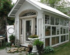 glass house made from old windows and doors
