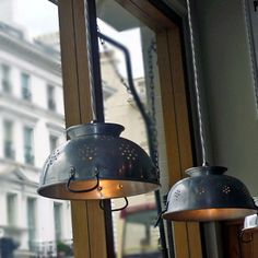 Use a kitchen colander to create unique pendant lights for a kitchen or outdoors on a patio.    When switched on they give off wonderful patterns and add atmosphere.    Use a drill and hole saw to drill out a hole in the base of the colander that is the right size to fit the lamp fitting through.