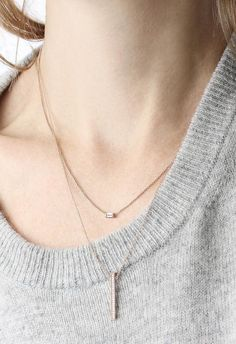 The dainty Baguette Necklace paired with our Diamond Line Necklace, both in 14k Rose Gold | Vrai & Oro
