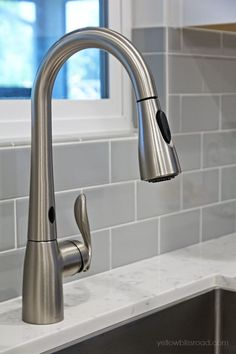 Love the subway tile and the counter top. Gray and White Kitchen Reveal