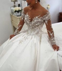 Satin Wedding Dresses Get off the shoulder long sleeve beaded bridal gown choices like this from Darius Designs. Rhinestone and crystals adorn the ball gown. Custom Wedding Dress, Dream Wedding Dresses, Bridal Dresses, Wedding Gowns, Couture Dresses, Wedding Dresses With Bling, Bling Wedding, Wedding Cake, Ball Dresses