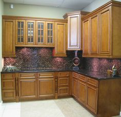 Gives a good idea what a darker backsplash would look like... (ignore white floor and walls though, ew!)