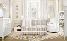 Traditional Nursery with Serena and lilly hudson crib, Pottery barn kids nursery bedding, Etched Trellis Rug, Crown molding